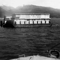 Barges loaded with flat-top houses
