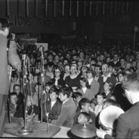 A Man Speaking Into A Microphone At The Trade Fair Opening