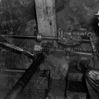 Worker using diamond drill